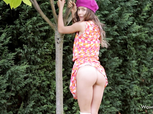 Teen Tease In The Garden Lifting Her Dress And Flashing